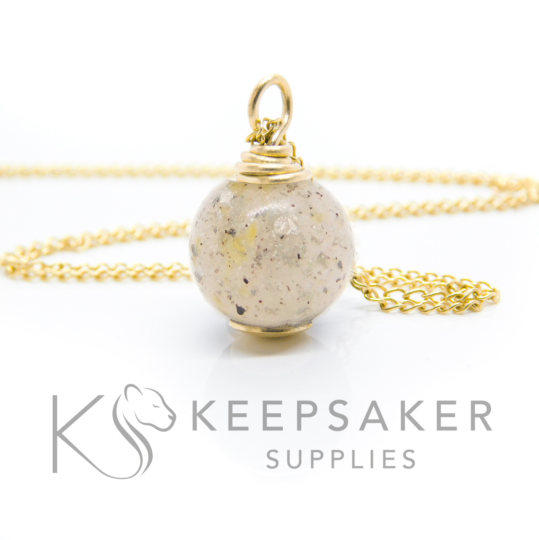 how to set a resin sphere or orb Solid 9ct gold breastmilk cord orb, breastmilk and two babies' umbilical cords, platinum leaf for 18 month breastfeeding awards (platinum boobies). No colour or shimmer added, 11mm sphere with hand wire wrapped setting shown with chain upgrade