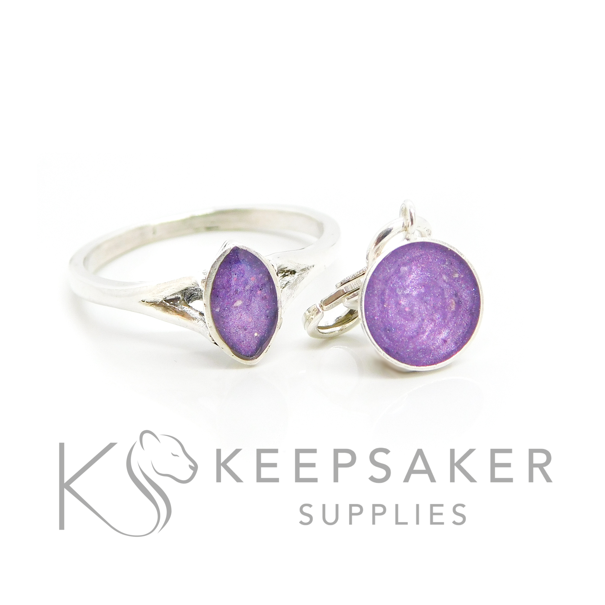 Filled Marquise Ashes Ring with Bonus Dangle Charm Cremation ashes Hannah marquise ring and little 8mm bezel cup, orchid purple resin sparkles. Solid silver hand finished marquise setting with split shank, plus tiny little dangle charm with lobster clasp.